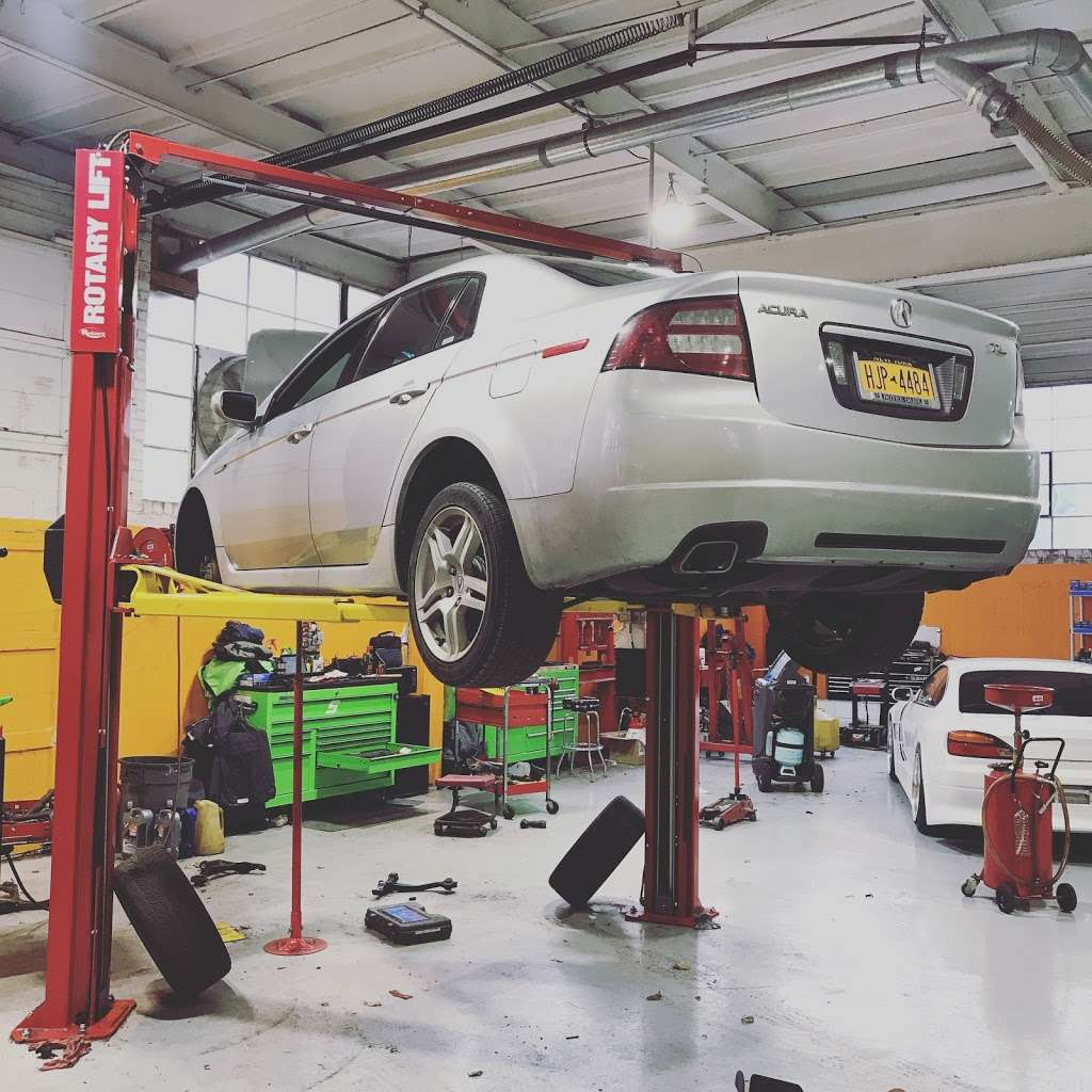 Essential Auto Care - car repair    Photo 2 of 10   Address: 69-90 73rd Pl, Middle Village, NY 11379, USA   Phone: (718) 301-6313