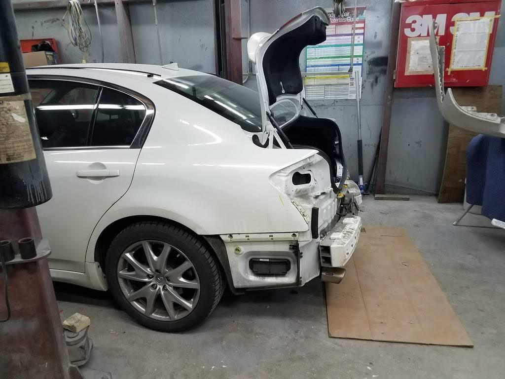 rj & g collision & automotive repair - car repair    Photo 4 of 10   Address: Hillsborough Bldg, 6215 Hillsborough St, Raleigh, NC 27606, USA   Phone: (919) 851-2411