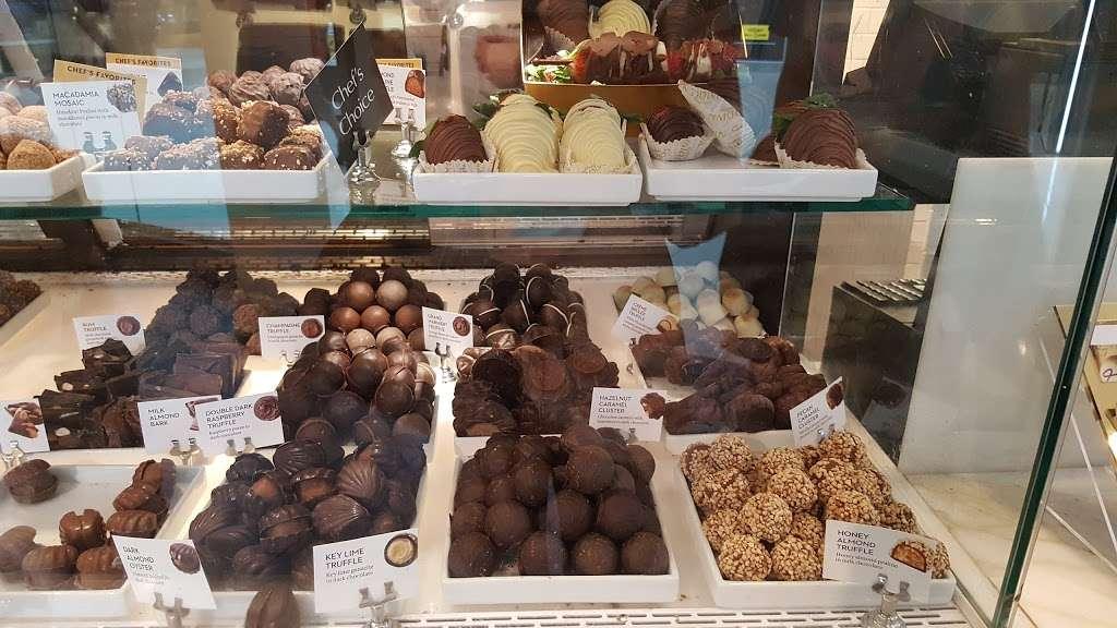 Godiva Chocolatier - store    Photo 3 of 10   Address: 8001 S Orange Blossom Trail, Orlando, FL 32809, USA   Phone: (407) 857-5549