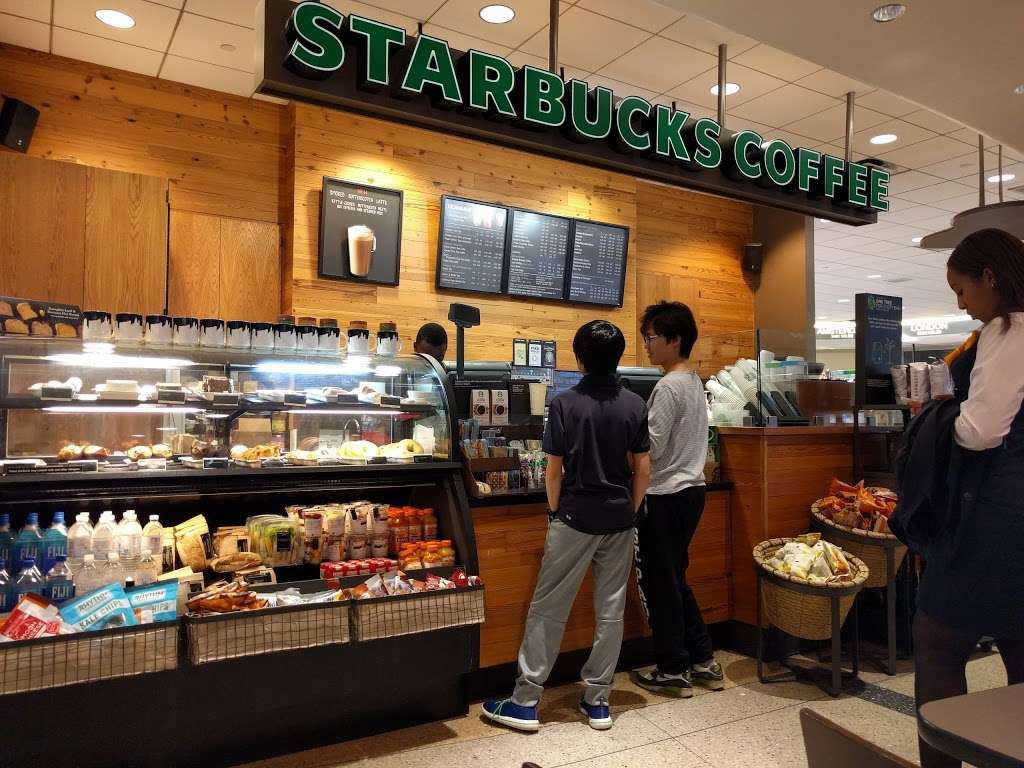 Starbucks - cafe  | Photo 1 of 5 | Address: Boston Logan International Airport (BOS), terminal C, Boston, MA 02128, USA | Phone: (617) 594-3506