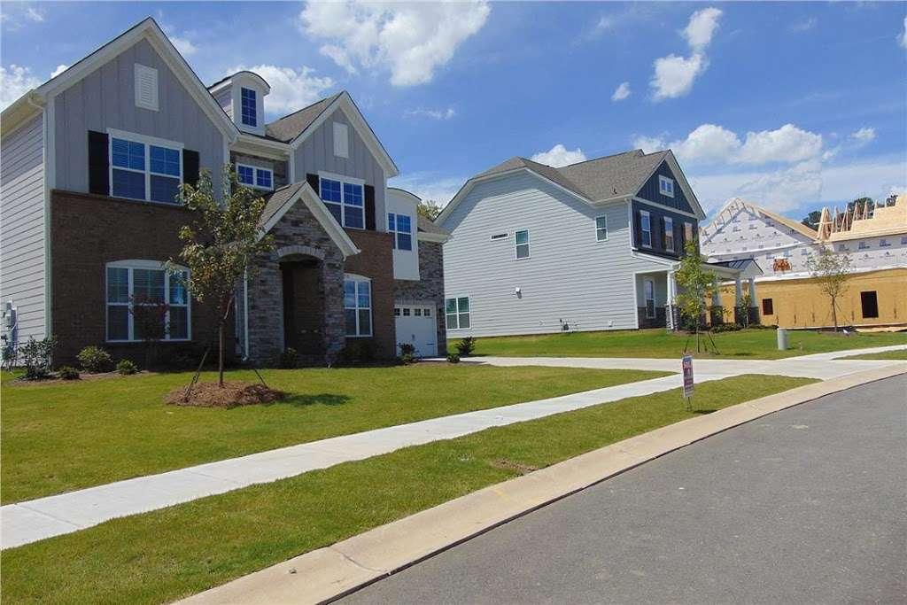 M/I Homes Blume - real estate agency  | Photo 4 of 10 | Address: 2045 Sweet William Drive, Harrisburg, NC 28075, USA | Phone: (704) 228-3892