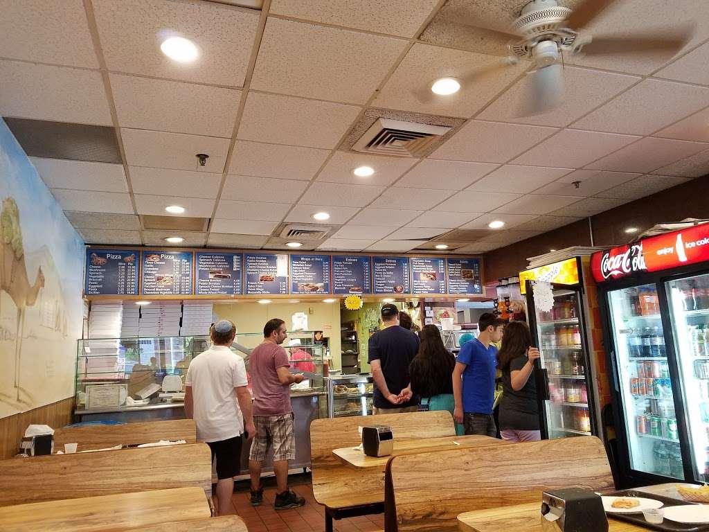 Shimons Kosher Pizza - restaurant  | Photo 1 of 10 | Address: 7124 Main St, Flushing, NY 11367, USA | Phone: (718) 793-1491