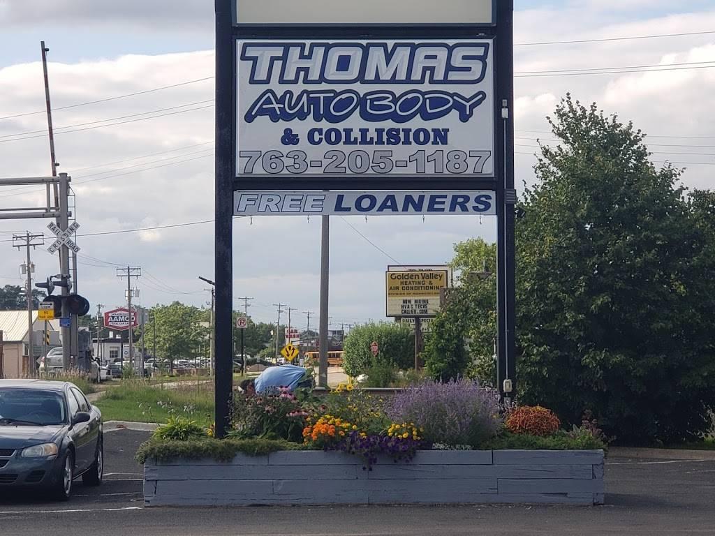 Thomas Auto Body & Collision - car repair    Photo 8 of 9   Address: 5170 W Broadway Ave, Minneapolis, MN 55429, USA   Phone: (763) 205-1187