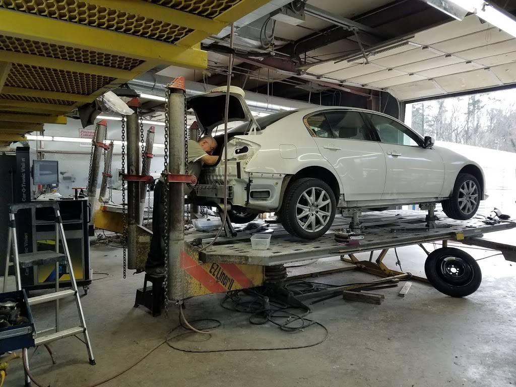 rj & g collision & automotive repair - car repair    Photo 2 of 10   Address: Hillsborough Bldg, 6215 Hillsborough St, Raleigh, NC 27606, USA   Phone: (919) 851-2411