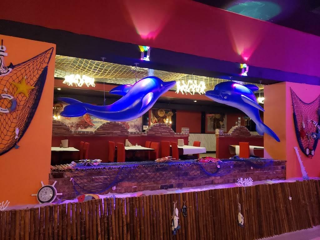 Mr. Q Crabhouse - restaurant    Photo 7 of 9   Address: 4221 N State Rd 7, Hollywood, FL 33021, USA   Phone: (954) 391-8879