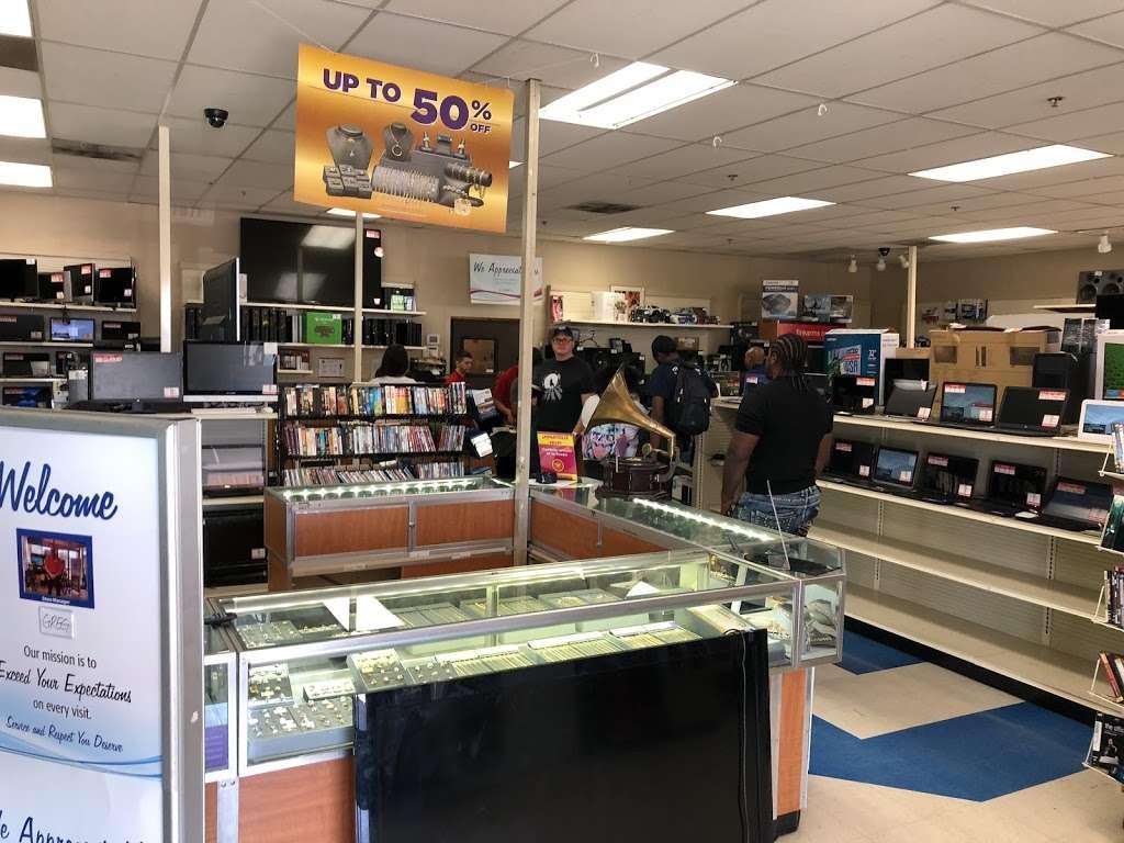EZPAWN - store  | Photo 1 of 8 | Address: 797 Peoria St Ste. E & F, Aurora, CO 80011, USA | Phone: (303) 367-5559