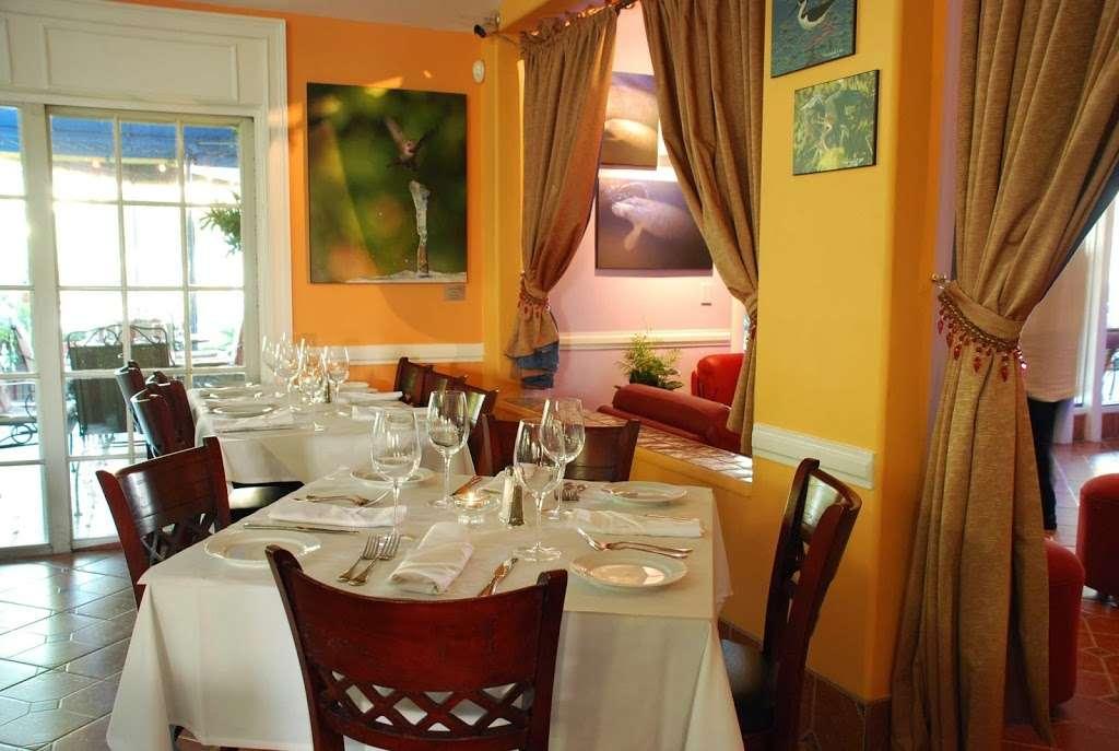 Patio Delray - restaurant    Photo 1 of 10   Address: 800 Palm Trail, Delray Beach, FL 33483, USA   Phone: (561) 279-0880