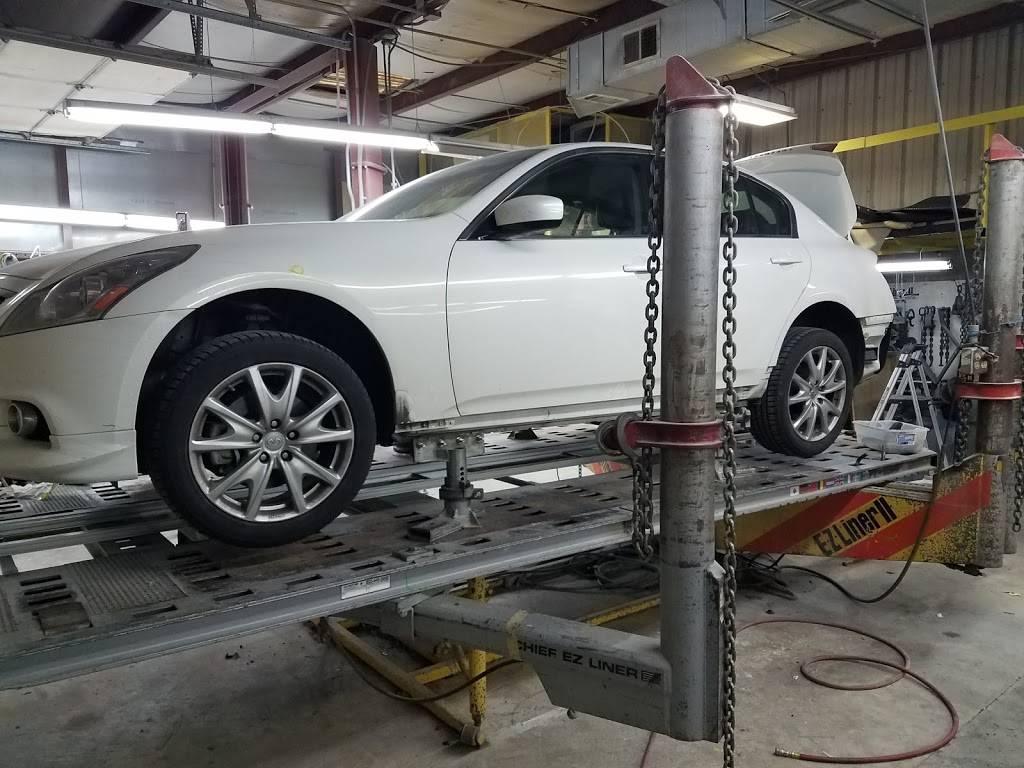 rj & g collision & automotive repair - car repair    Photo 3 of 10   Address: Hillsborough Bldg, 6215 Hillsborough St, Raleigh, NC 27606, USA   Phone: (919) 851-2411