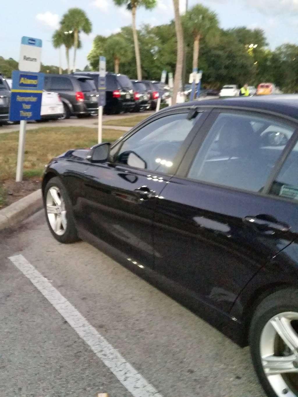Alamo Rent A Car - car rental  | Photo 4 of 8 | Address: 1000 Car Care Dr, Orlando, FL 32830, USA | Phone: (407) 824-3470