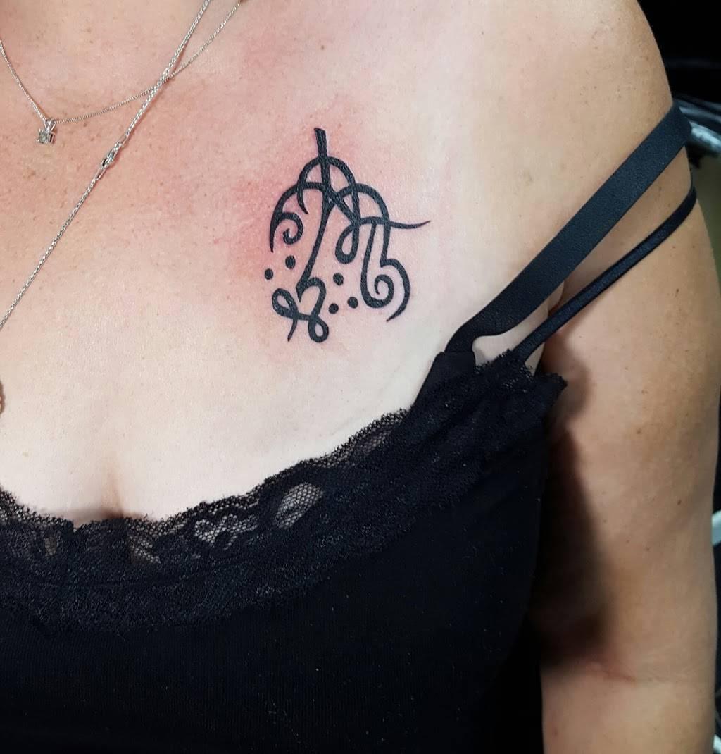 A Different Image Tattoo and Fine Art Studio - store    Photo 3 of 10   Address: 6212 SE 15th St, Oklahoma City, OK 73110, USA   Phone: (405) 739-0102