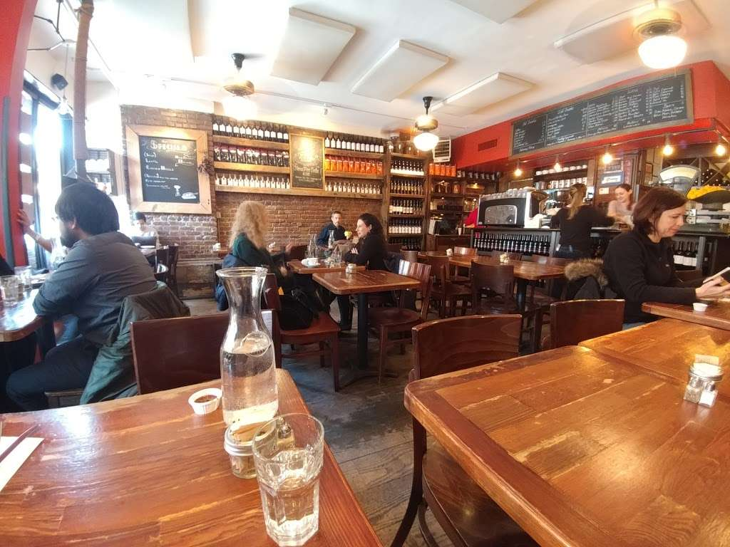 12 Chairs Cafe - restaurant  | Photo 1 of 10 | Address: 56 Macdougal St # B, New York, NY 10012, USA | Phone: (212) 254-8640