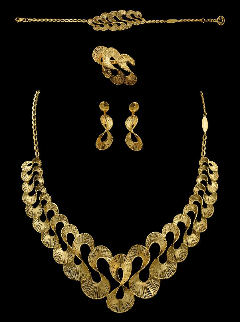 Yasini Jewelers 21k & 22k Gold - jewelry store    Photo 9 of 10   Address: 3110 W Devon Ave, Chicago, IL 60659, USA   Phone: (773) 274-6450