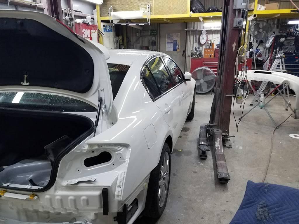 rj & g collision & automotive repair - car repair    Photo 8 of 10   Address: Hillsborough Bldg, 6215 Hillsborough St, Raleigh, NC 27606, USA   Phone: (919) 851-2411